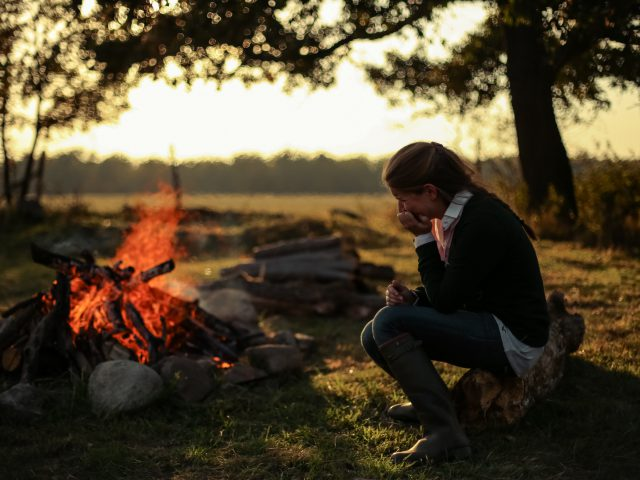 Girl by the fire