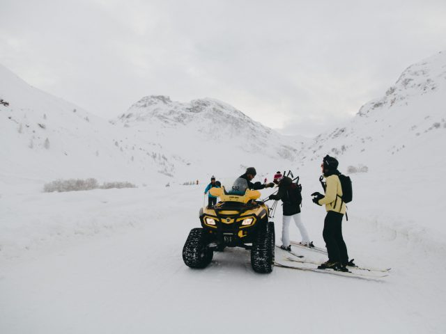 Skiers and ATV