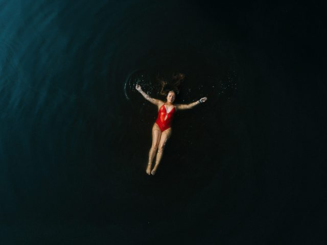 Girl swimming from above