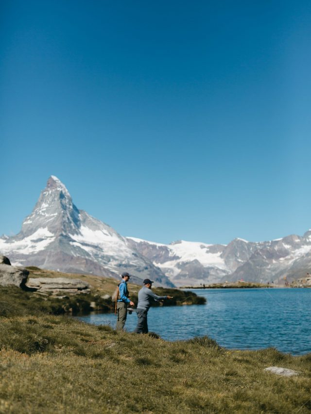 Fly fishers at the foot of the Matterhorn